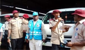 Deputy Corps Commander, Federal Road Safety Corps(FRSC), Edo State Sector Command,  Mr Obisike Uchendu (2nd right) and other officers enlightening motorists on the dangers of over  speeding, during the Annual West Africa Road Safety Organisation Day  in Benin, recently.