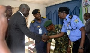 Rivers State Commissioner of Police, Mr Musa Kimo (right), welcoming the State Commissioner for Chieftaincy and Community Affairs, Hon. John Bazia (2nd left), to the Town Hall meeting on Security Challenges organised by the Commissioner of Police at Police Officers Mess, Port Harcourt, yesterday. With them are Service Chiefs.          Pix: Nuieh Donatus Ken
