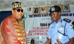 Chairman, Rivers State Traditional Rulers' Council and Amanyanabo of Opobo, King Dandeson Jaja in a handshake with the Commissioner of Police, Mr Musa Kimo (left), during a Town Hall meeting on Security Challenges between local communities and herdsmen organised by the police in Port Harcourt, yesterday