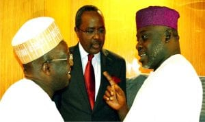 Chairman, House Committee on Capital Market, Rep. Yusuf Tajuddeen (right), discussing with representative of the Minister of Finance,  Dr Mahmud Isa-Dutse (left) and Director-General, Security and Exchange Commission (SEC), Alhaji Munir Gwarzo, at the inauguration of the study team on Voice and Voting Power in the Nigerian Capital Market in Abuja on Monday.