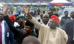 Vice President, Yemi Osinbajo (left) and Governor Akinwunmi Ambode of Lagos State (right), acknowledging cheers from the crowd on arrival, at Tafawa Balewa Square, venue for the inauguration of some security equipment, during the working visit of the Vice President to Lagos State as representative of President Muhammadu Buhari on Monday.
