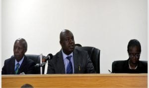 Chairman, Commission of Inquiring, Hon Justice Monima W Danagogo (middle), addressing participants at the inaugural sitting of the commission in Port Harcourt on Monday. With him are members of the commission Engr Luke Nwanodi (left) and Mrs Constance Douye Green