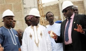L-R: Member, House Committee on Industries, Mr Emmanuel Akpan, Chairman of the Committee, Alhaji Abubakar Moriki, Managing Director, Hortigraph Nigeria Limited, Alhaji Murtala Abubakar and Acting Director-General, Standards Organisation of Nigeria (SON), Dr Paul Angga, during an inspection tour of National Meteorology Institute in Enugu on Monday.