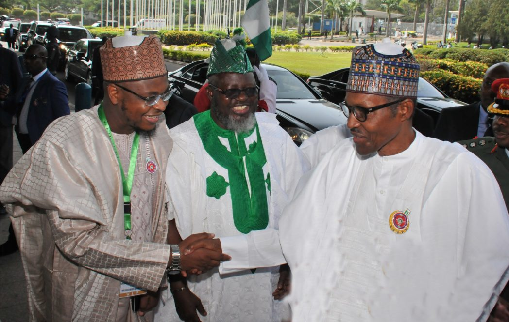 """Director-General, National Information Technology Development Agency (NITDA), Dr Isa Ibrahim (left), welcoming President Muhammadu Buhari to the 2017 e-Nigeria Conference with the theme: """"Fostering Digital Economy Through Local Content Development and Effective Regulations'' in Abuja, last Tuesday. With them is the Minister of Communication, Mr Adebayo Shittu."""