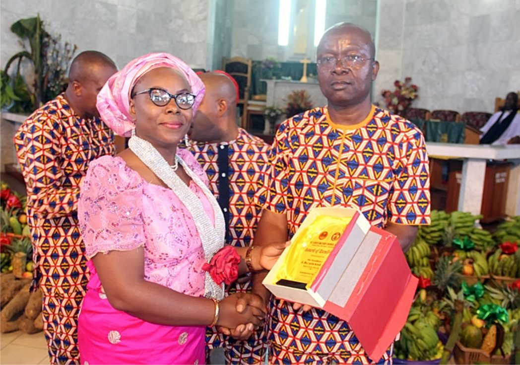 Representative of the Rivers State Deputy Governor and  Special Assistant on Social Media, Miss Uki Asemota, receiving an Award from the Chairman, 2017 Harvest Committee of St. Jude's Military Church (PROT), Brig. Gen. Nae Okeji, during the Adult Harvest Thanksgiving Service in Port Harcourt, yesterday.