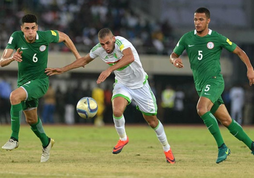 Super Eagles defender Leon Balogun (6) and Troost Ekong (5) closing in on Algerian attacker when both teams met in their final Russia 2018 qualifier, last Friday.